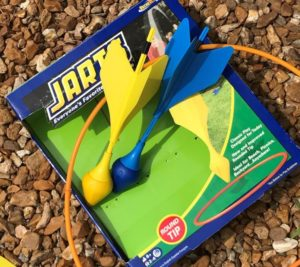 Jarts of yellow and blue that is played at the Dickson company on a regular basis.