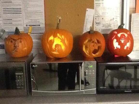 A few of our employees carved up some pumpkins.