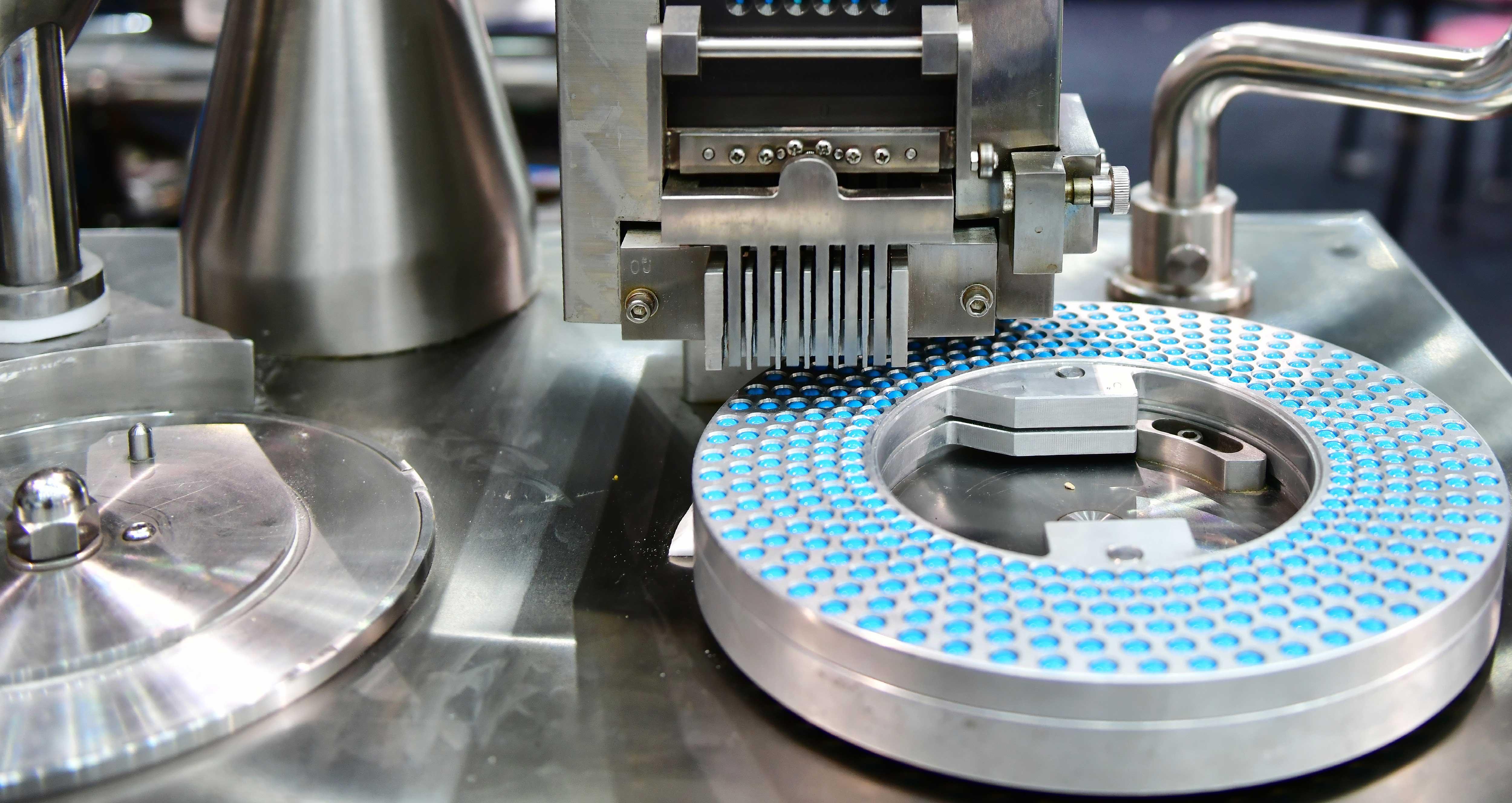 blue-capsule-medicine-pill-production-line-industrial
