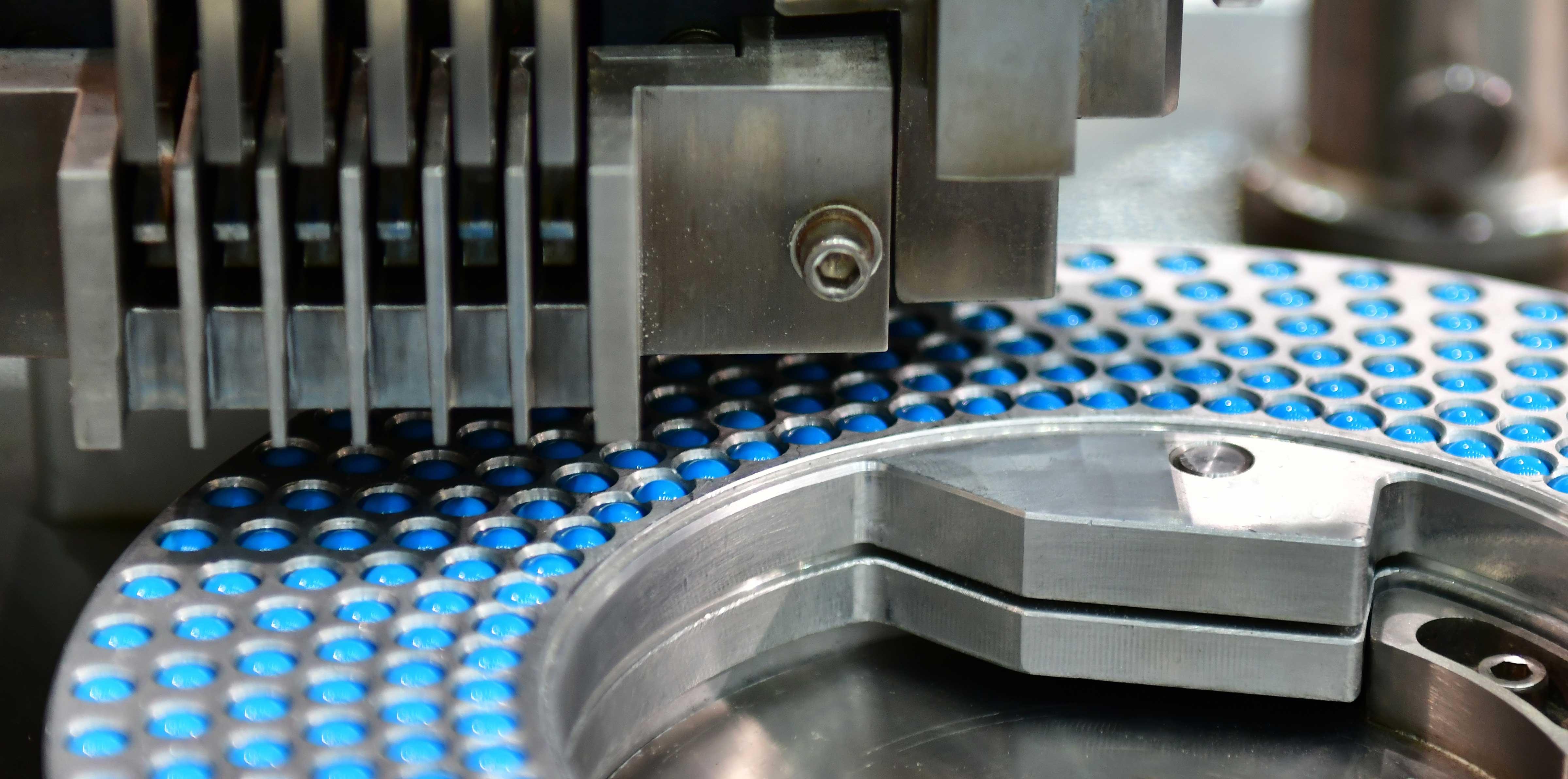 blue-capsule-medicine-pill-production-line