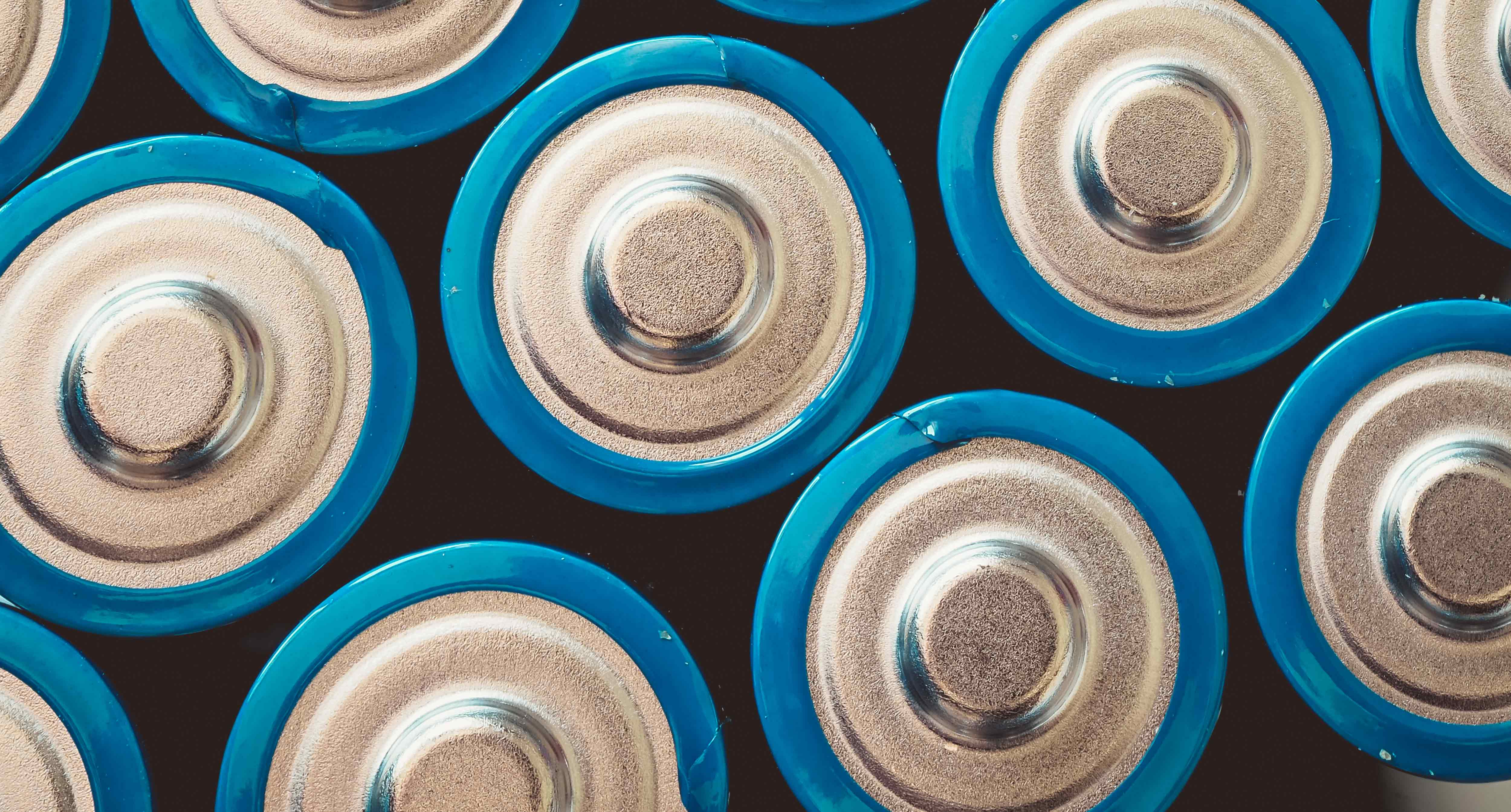 high-angle-shot-group-blue-batteries-surface