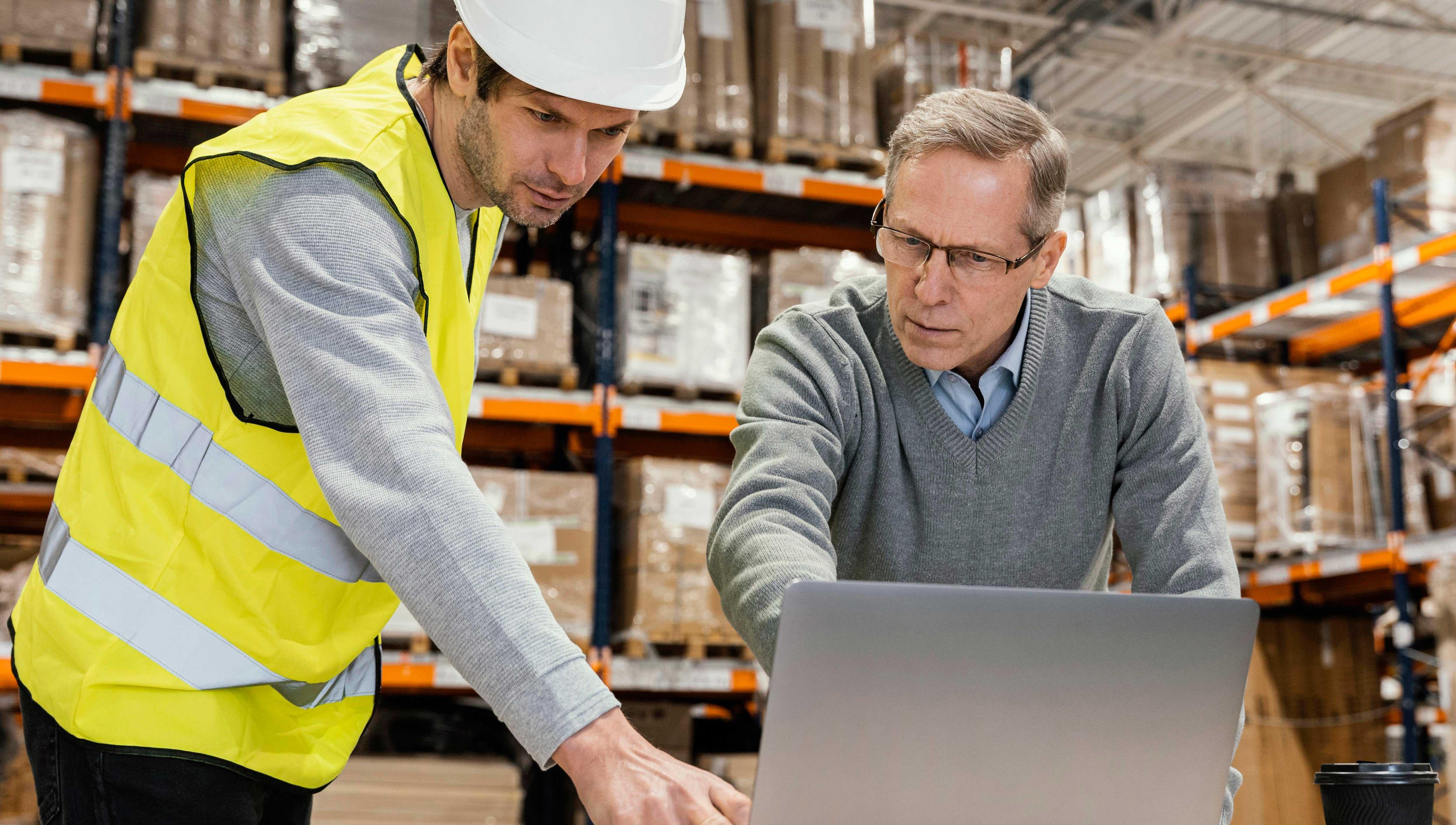 men-warehouse-working-laptop
