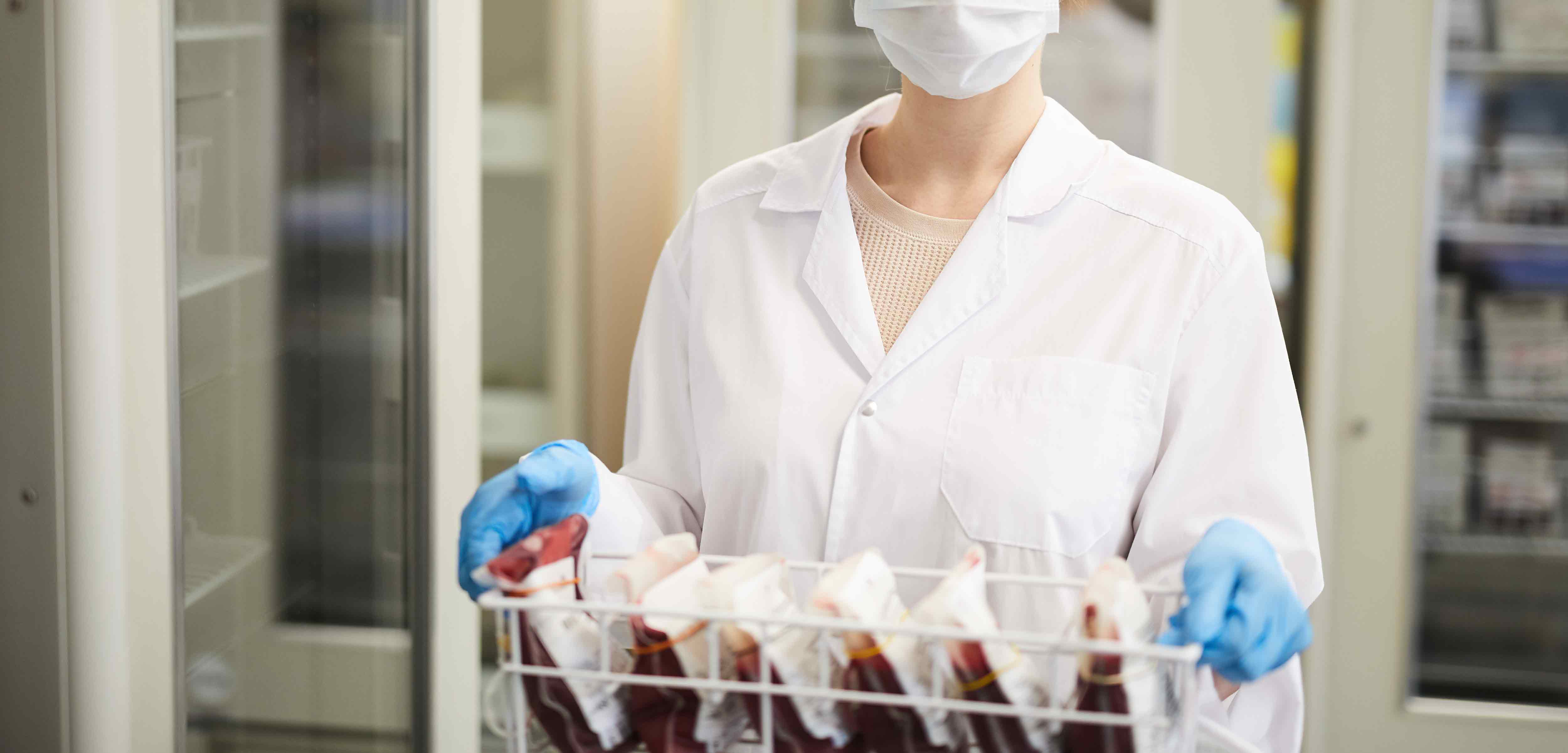 portrait-nurse-mask-white-coat-carrying-box-with-blood-samples-lab
