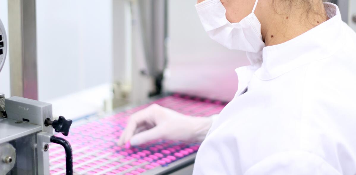 Woman working in pharmaceutical production