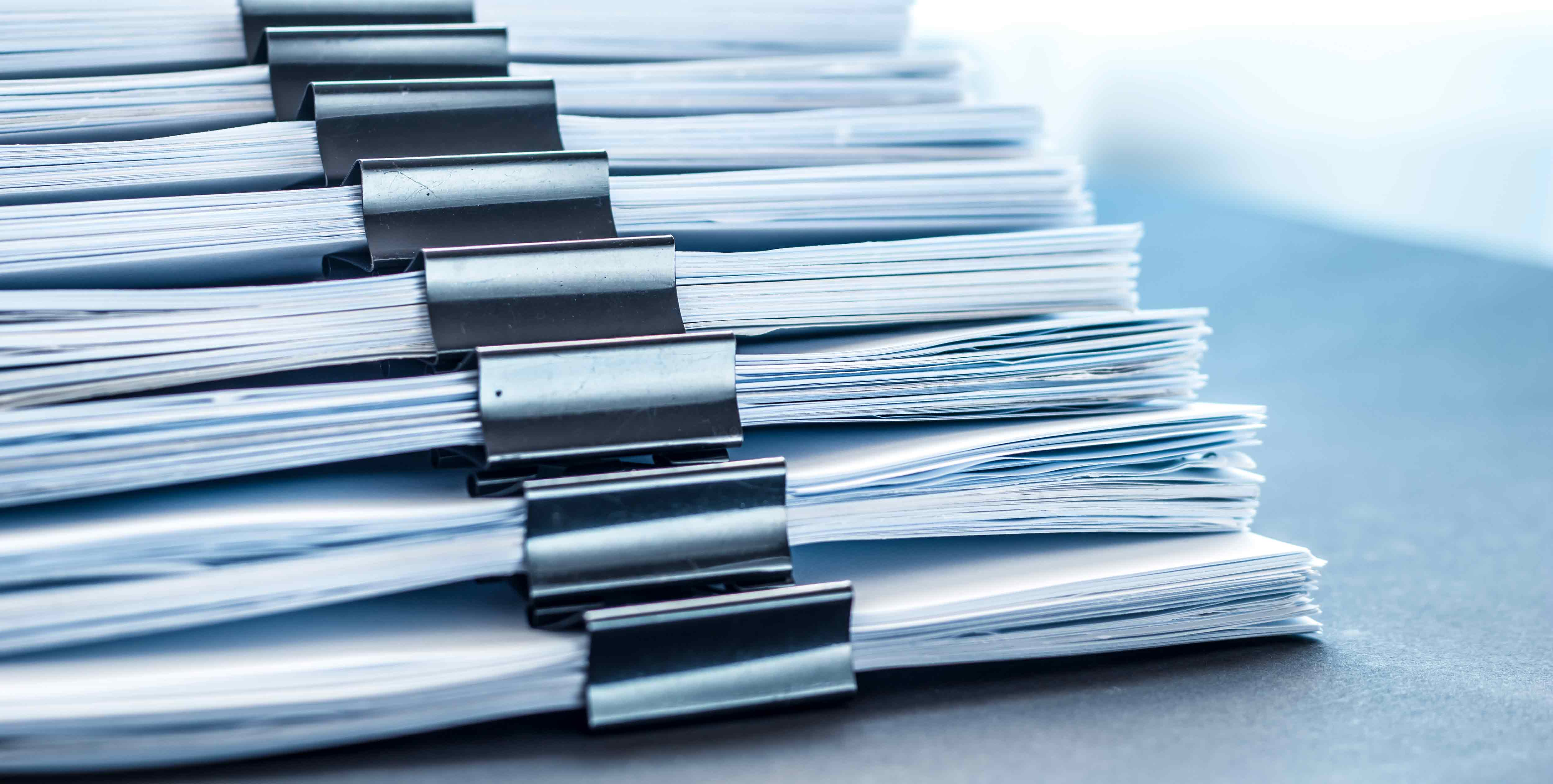 stacks-documents-files-with-black-clip
