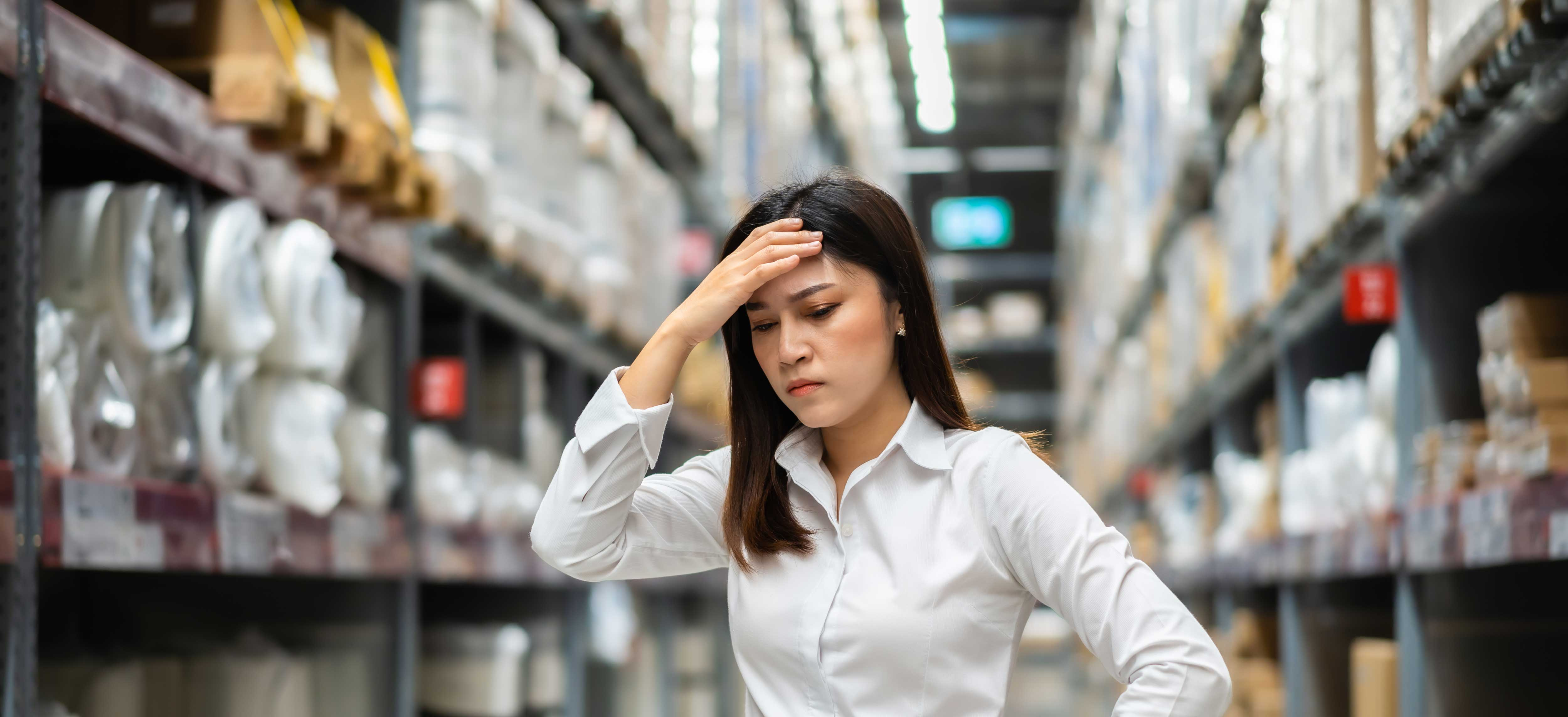 stressed-female-manager-warehouse-store